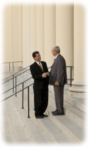 Two attorneys shaking hands on court steps